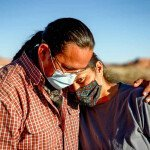 A Navajo husband and wife encourage one another because of the Coronavirus curfew by the Tribal Council in Arizona